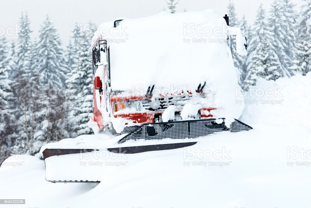 Snow groomer covered by snow stock photo