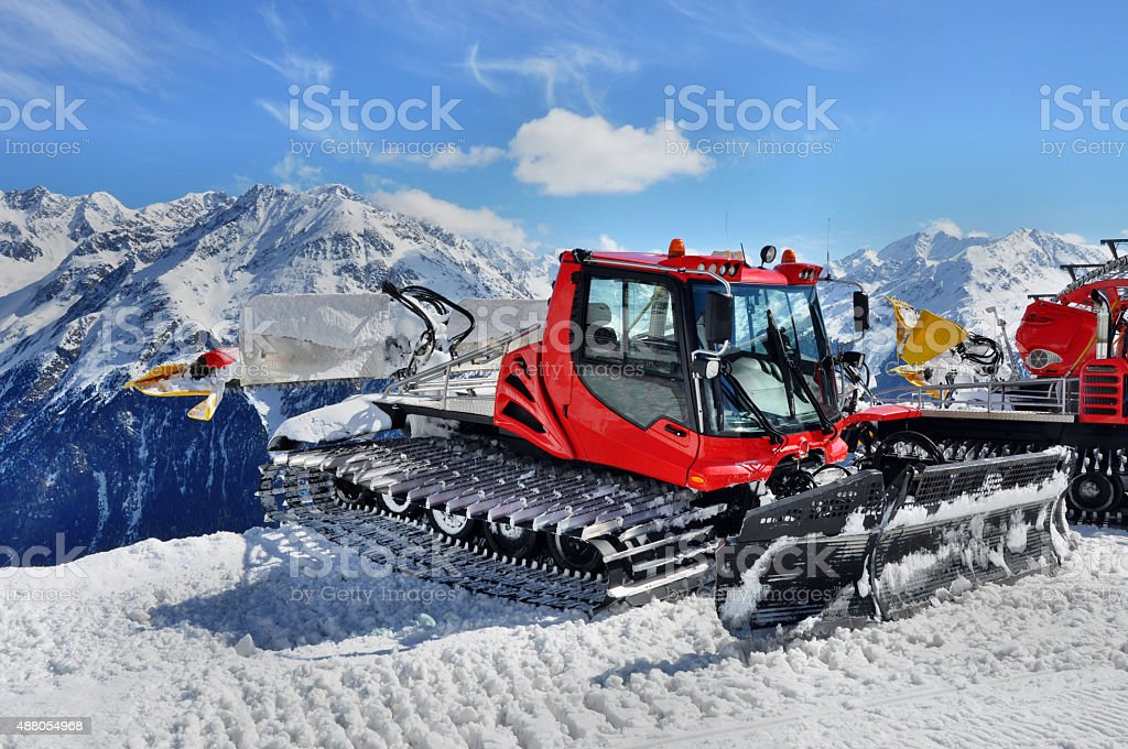 Snow Groomer in Alps stock photo