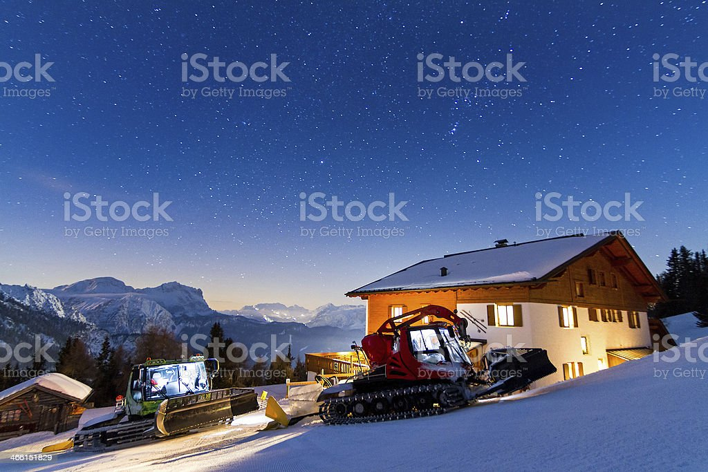 Snow groomer nightscape stock photo