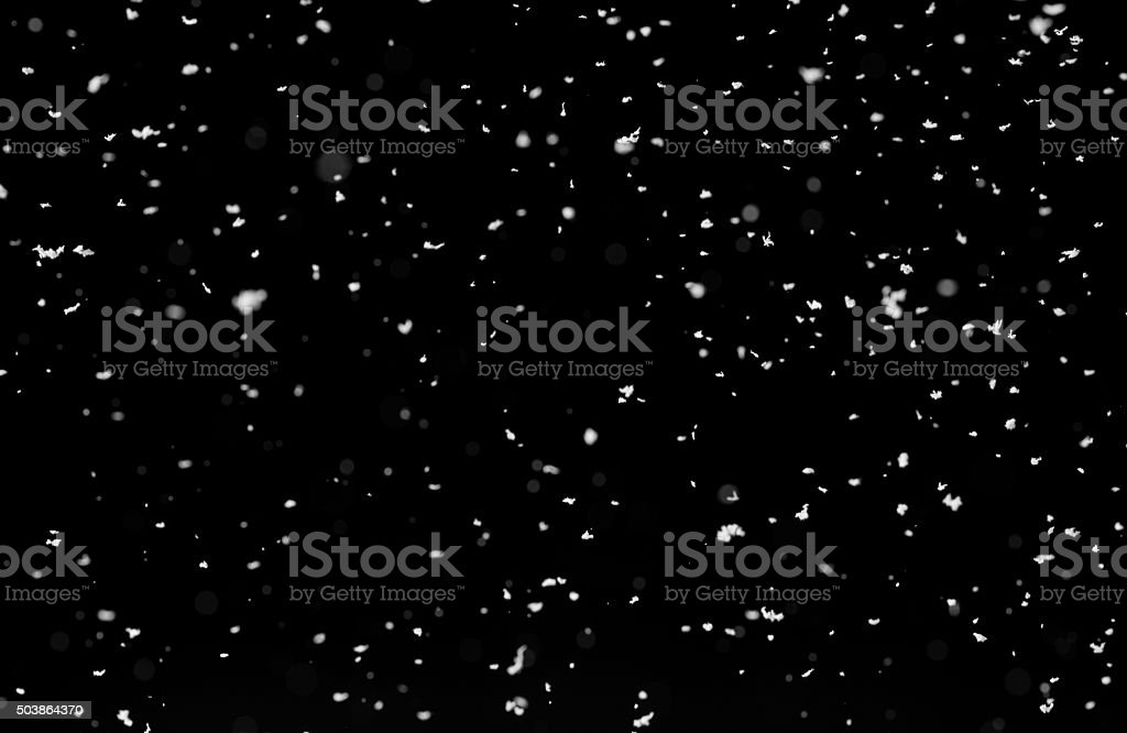 Snow isolated on black background stock photo