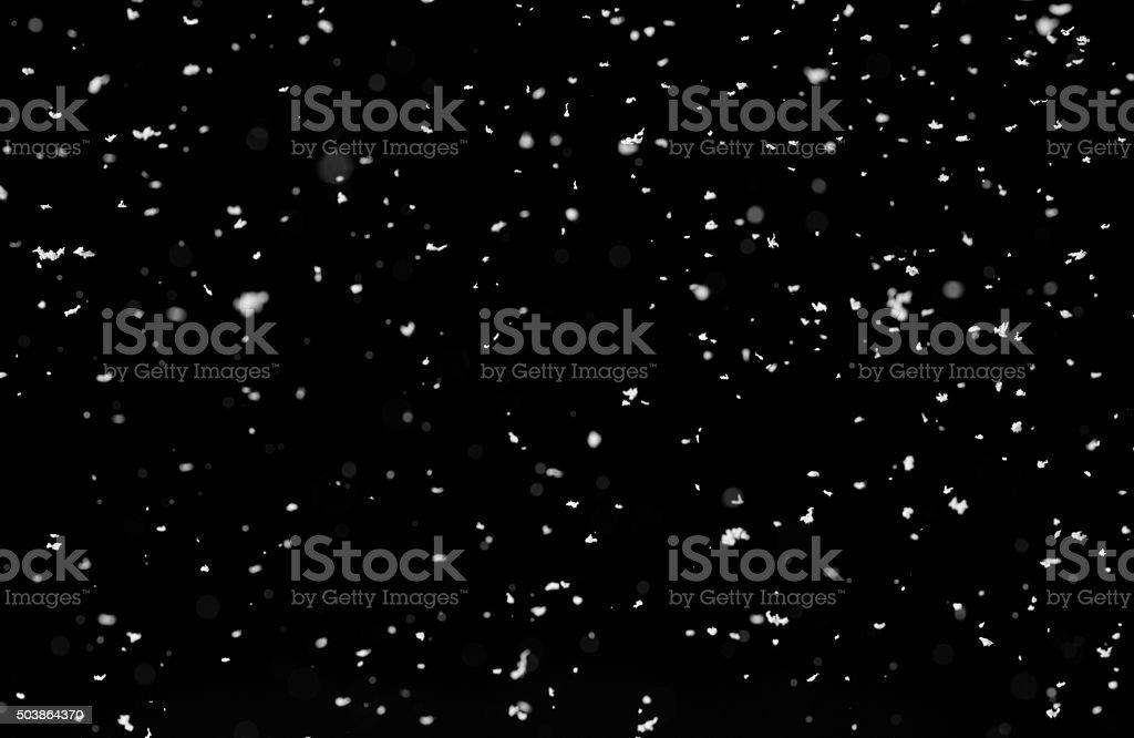 Snow isolated on black background stock photo