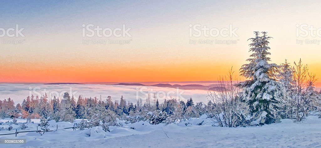 Snow landscape in the evening with sunset stock photo