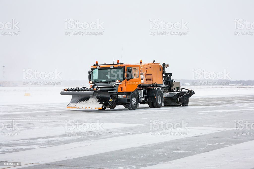 Snow machine for universal cleaning on the winter runway royalty-free stock photo