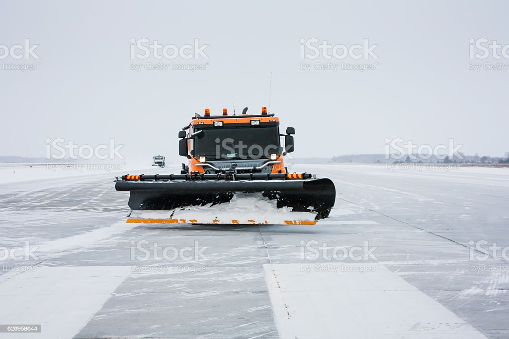 Snow machines on the winter runway royalty-free stock photo