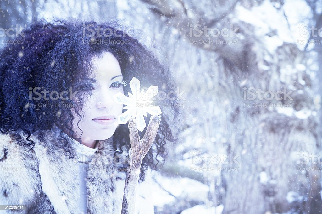 Snow Maiden With Crystal In A Winter Storm stock photo
