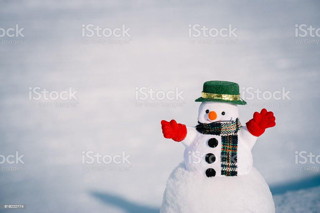 Snow man stand among pile of snow. stock photo