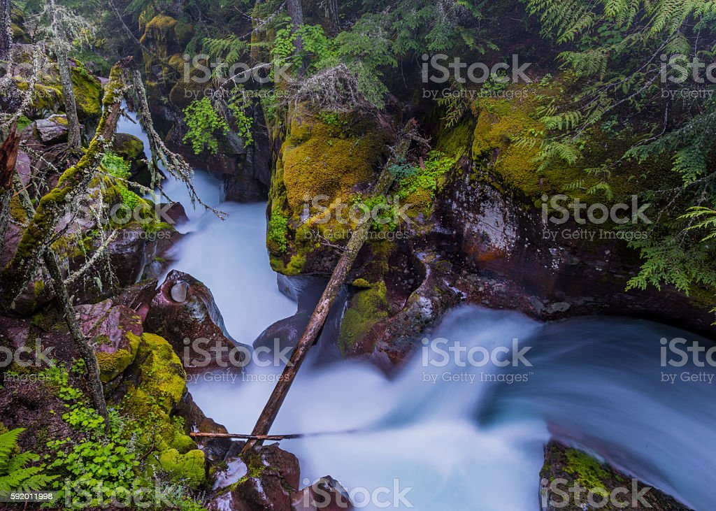 Snow Melt Water Powers through the Rock stock photo