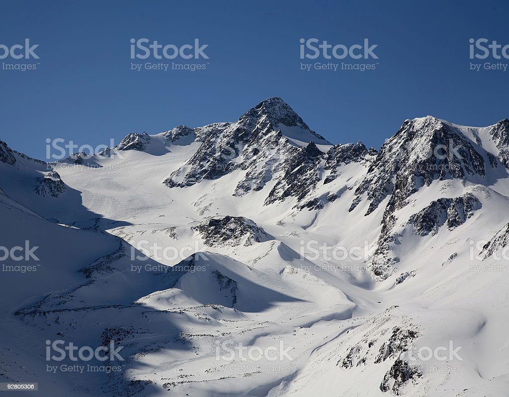 snow mountain against blue sky stock photo