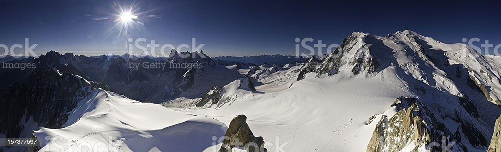 Snow mountain blue sunburst stock photo