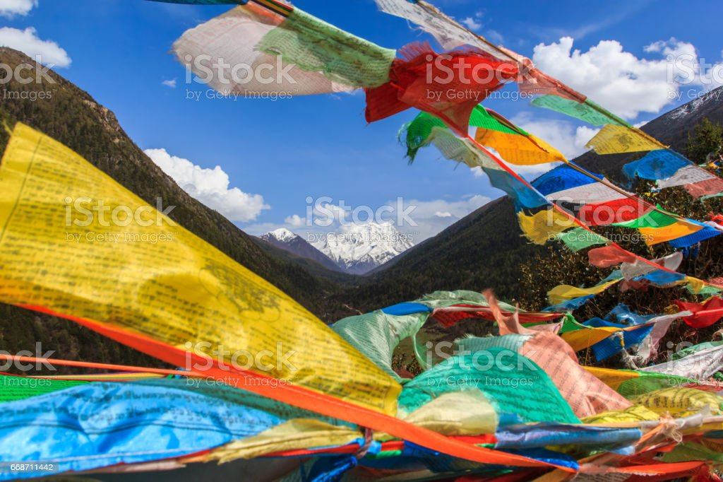 Snow mountain in China Southwestern in Sertar County of Garze Tibetan Autonomous Prefecture, in Tibet, Kham, China, with blurred prayer flags in foreground. stock photo
