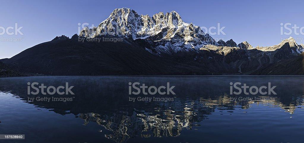 Snow mountain peaks reflected Gokyo lake mist Himalaya Nepal panorama royalty-free stock photo
