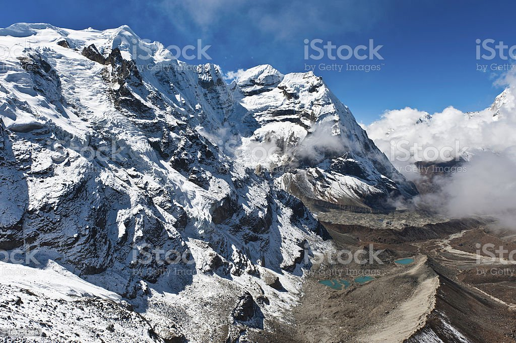 Snow mountain summit glacier valley vista remote wilderness Himalayas Nepal stock photo