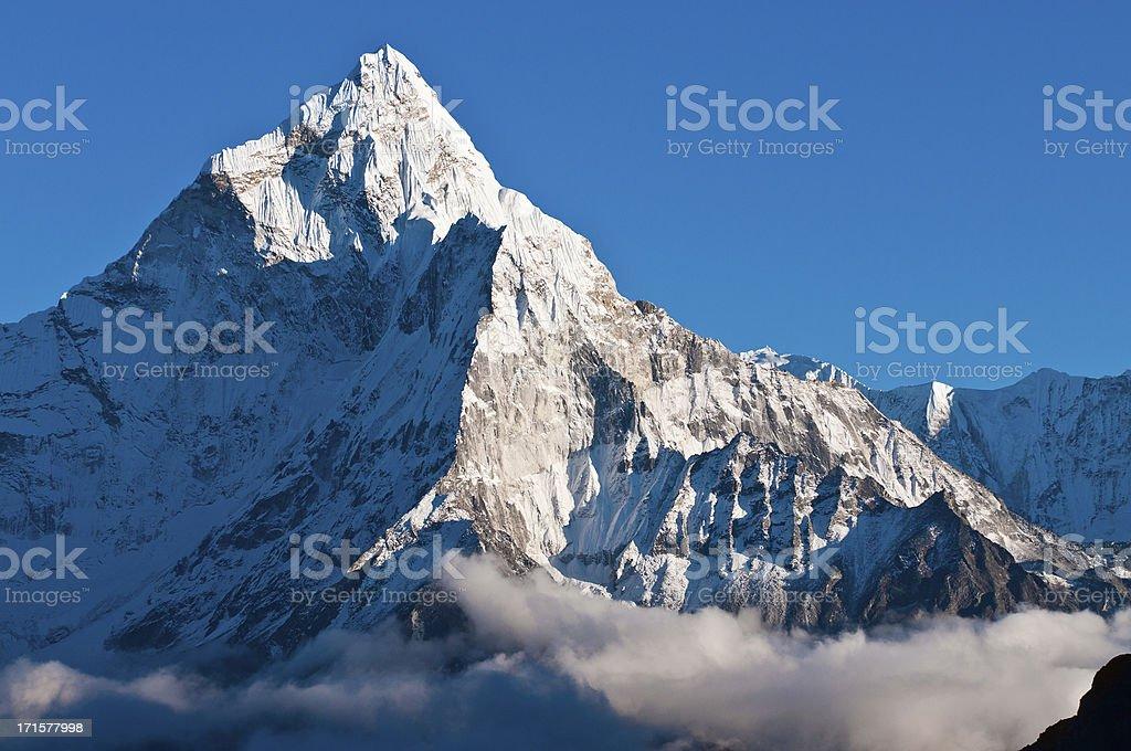 Snow mountain summit pinnacles dramatic high altitude ridges Himalayas Nepal royalty-free stock photo
