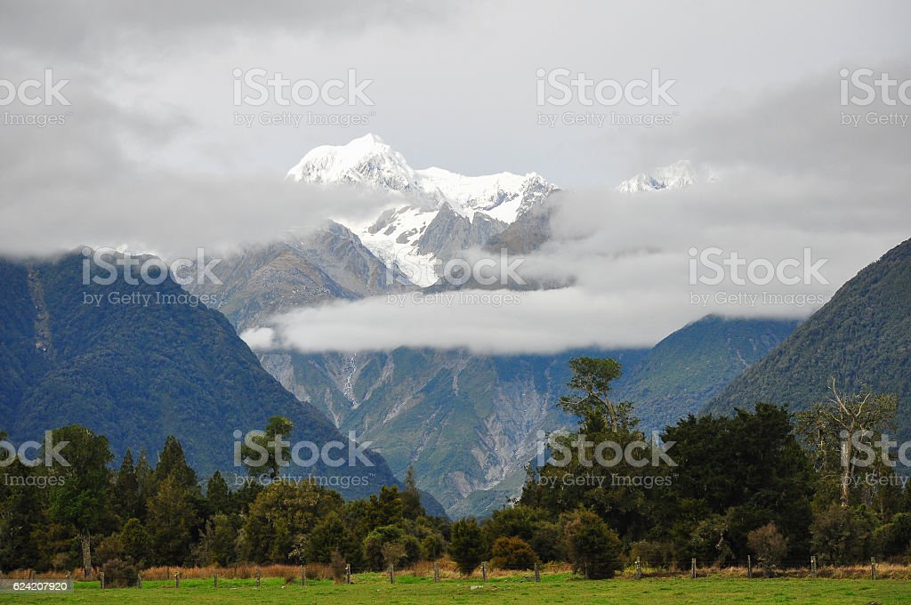 Snow mountain  with clouds cover stock photo