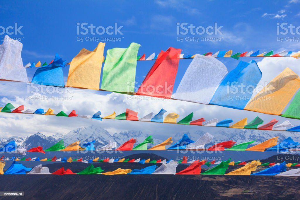 Snow mountain with prayer flags, Deqing city, Yunnan, China stock photo
