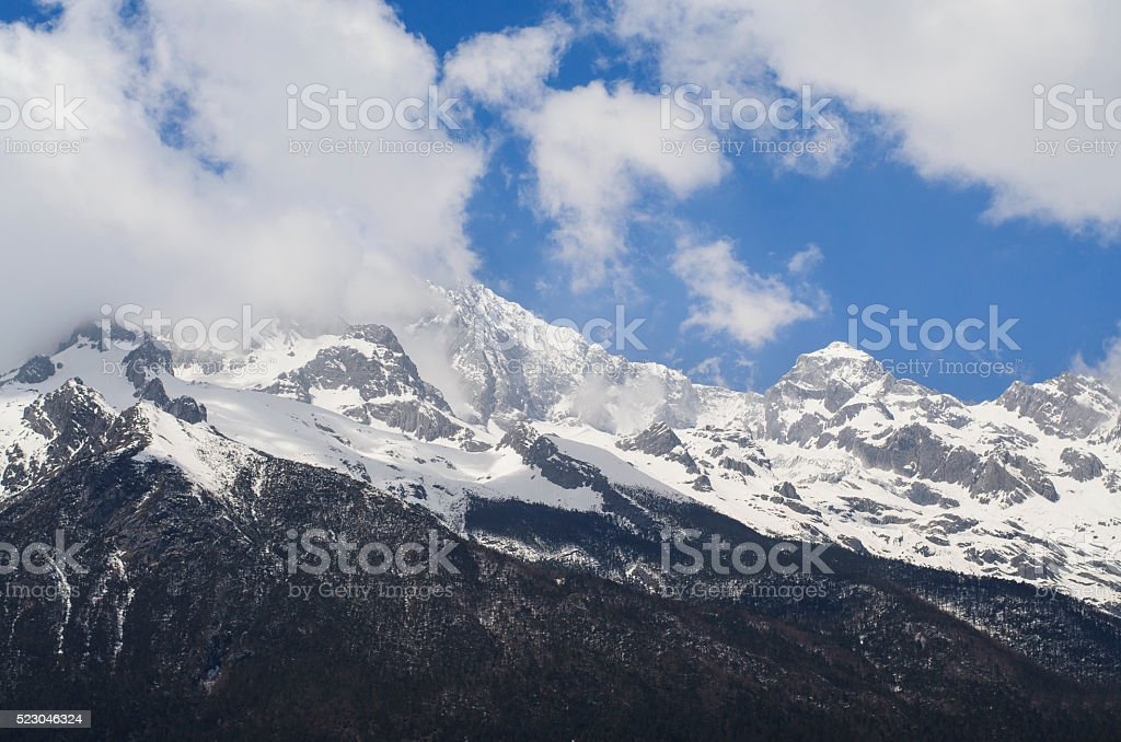Snow mountains and mist stock photo