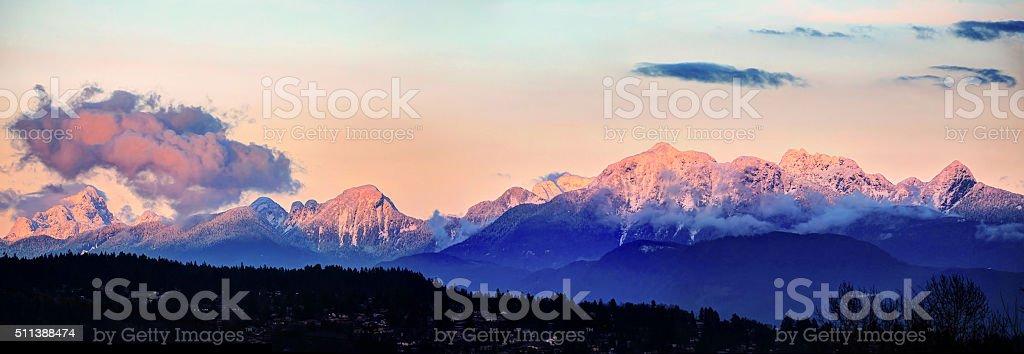 Snow Mountains at sunset stock photo