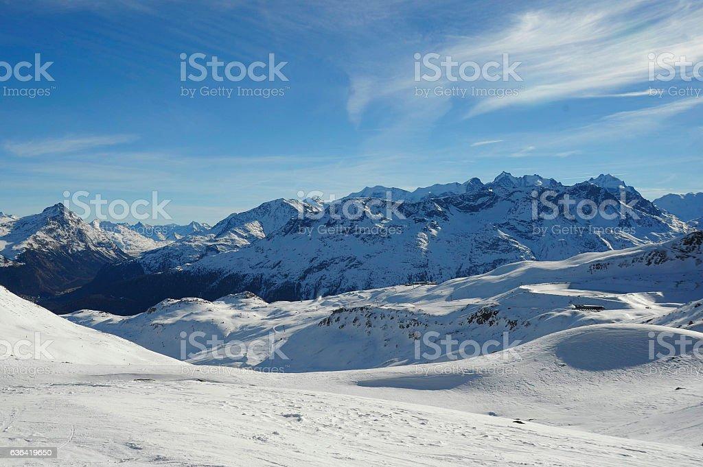 snow mountains  ski resort in Switzerland Europe cold sunny day stock photo