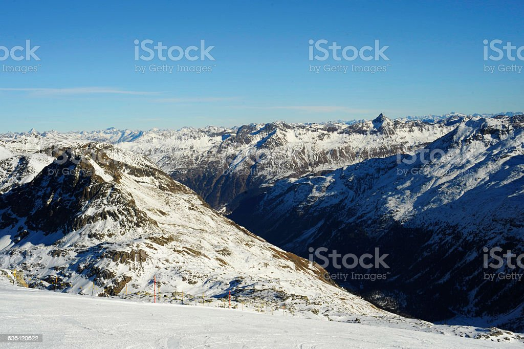 snow mountains  ski resort in Switzerland Europe cold sunny day stock photo
