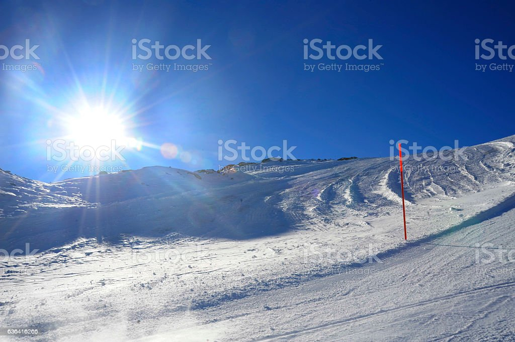 snow mountains ski slope in Switzerland Europe cold sunny day stock photo