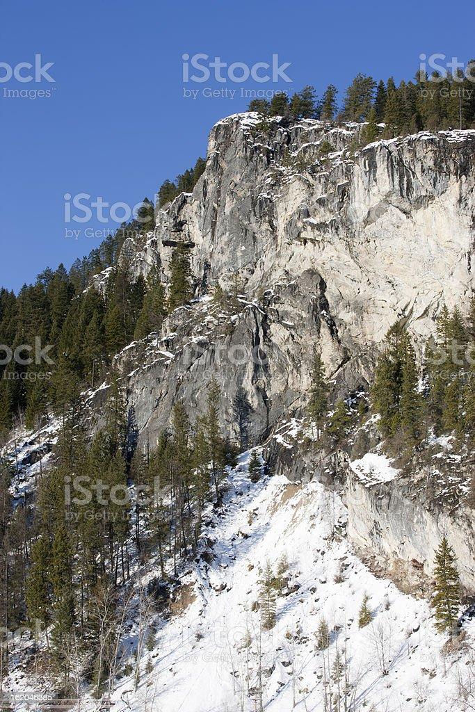 Snow near granite cliff. royalty-free stock photo