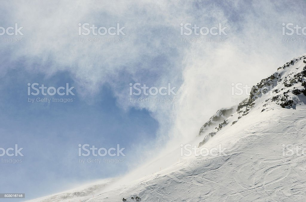 Snow on a Mountain in a Swirl of Wind stock photo
