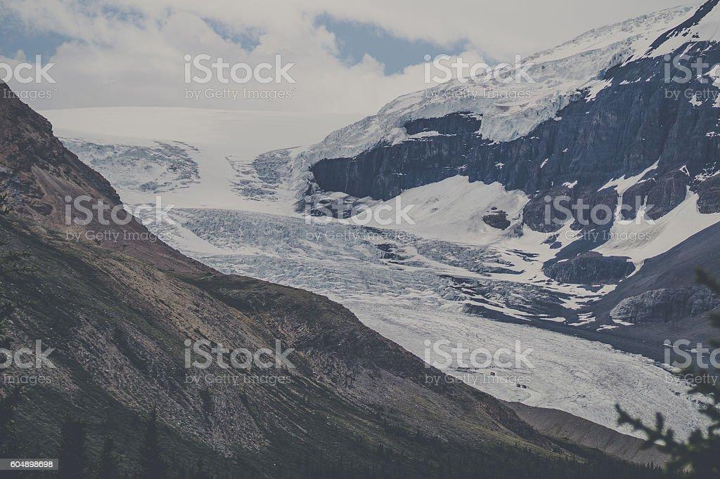 Snow on a rough mountain top stock photo