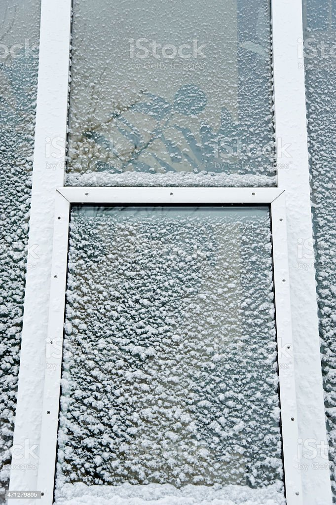 Snow on a window stock photo