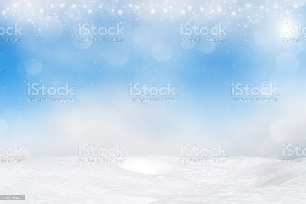 Snow on abstract blue bokeh background stock photo