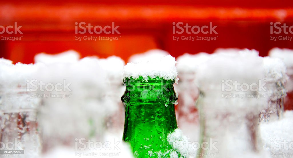 Snow on an open drinking bottle stock photo