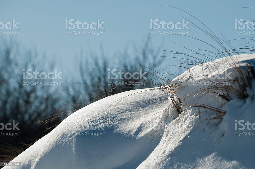 Snow on dune stock photo