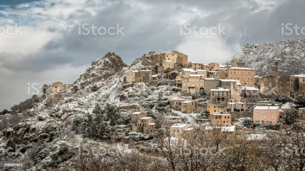 Snow on mountain village of Speloncato in Corsica stock photo