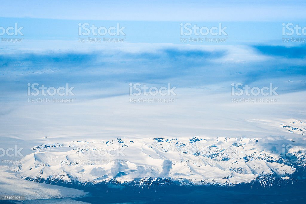 Snow on mountains in iceland stock photo