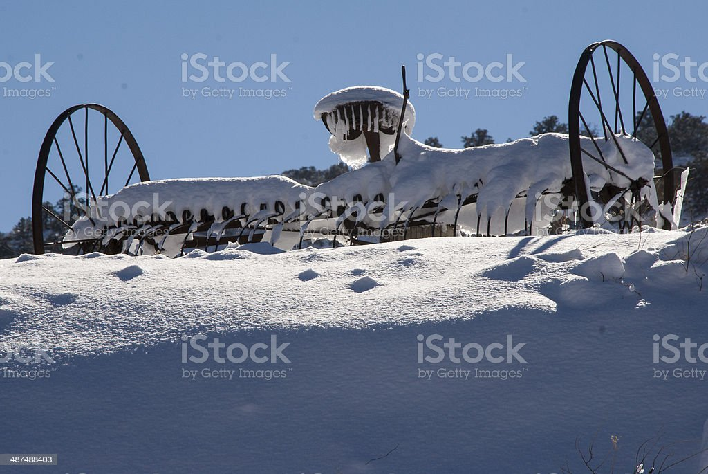Snow on old Agricultural Equipment Rockville Utah stock photo