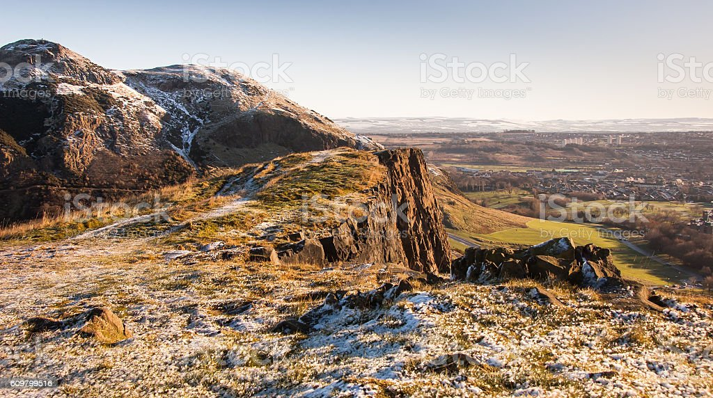 Snow on Salisbury Crags stock photo