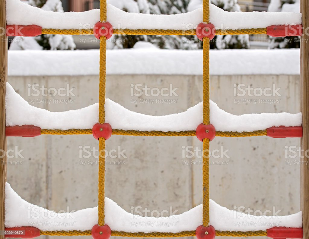 snow on the climb net rope stock photo