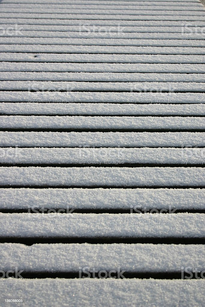 Snow on the planks royalty-free stock photo