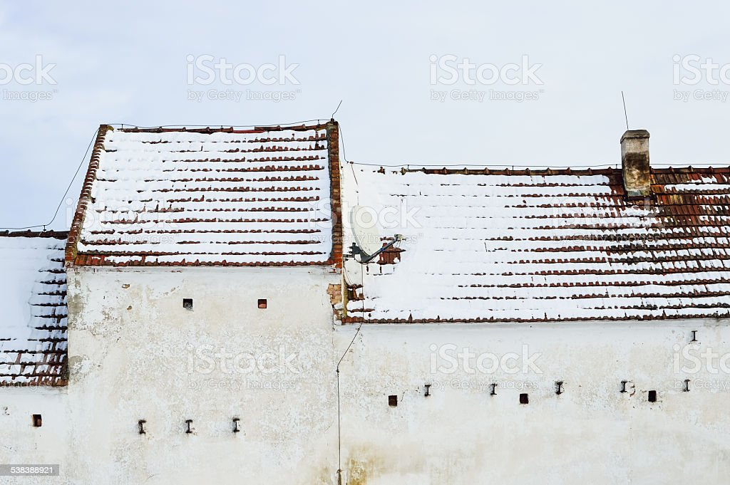 Snow on the roof of an old house stock photo