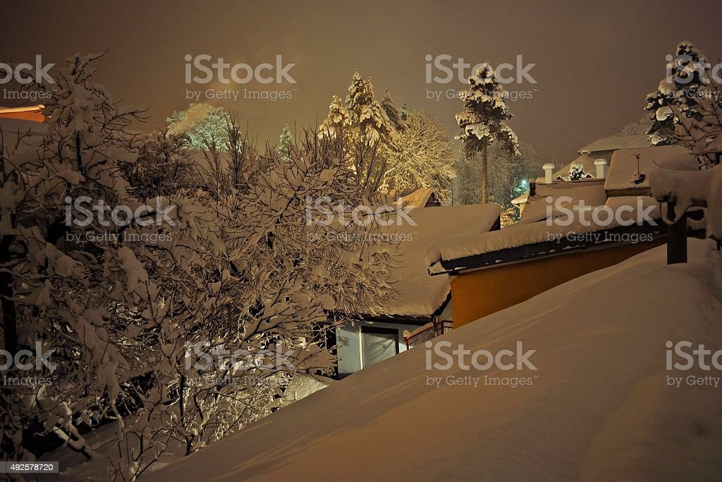 Snow on the roof of the house stock photo