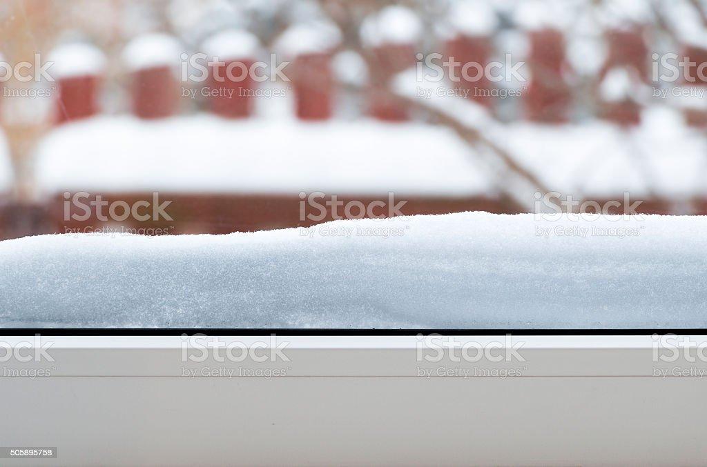 Snow on the window sill stock photo