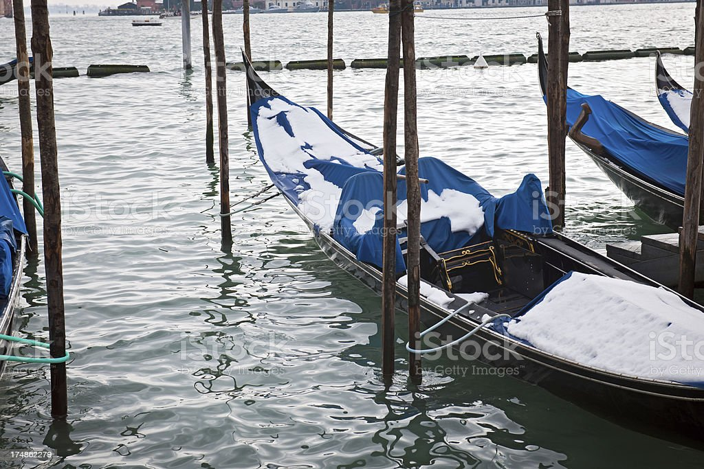 Snow on Venetian Gondolas Grand Channel Italy royalty-free stock photo