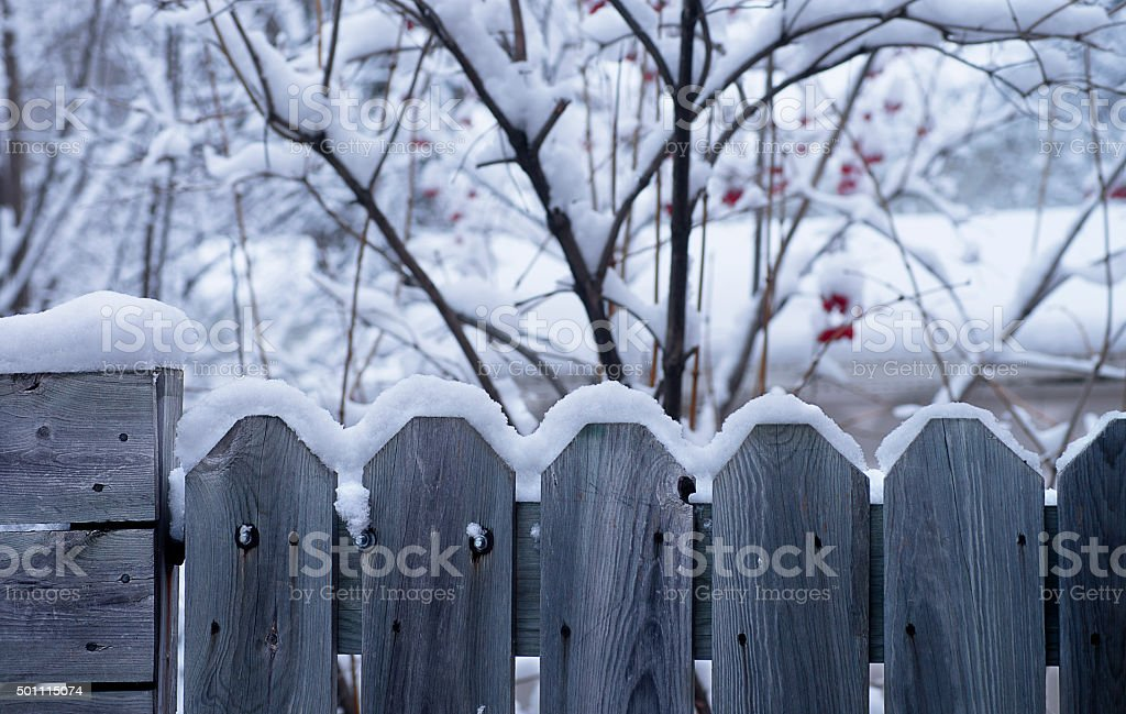 Snow on Wood Fence stock photo