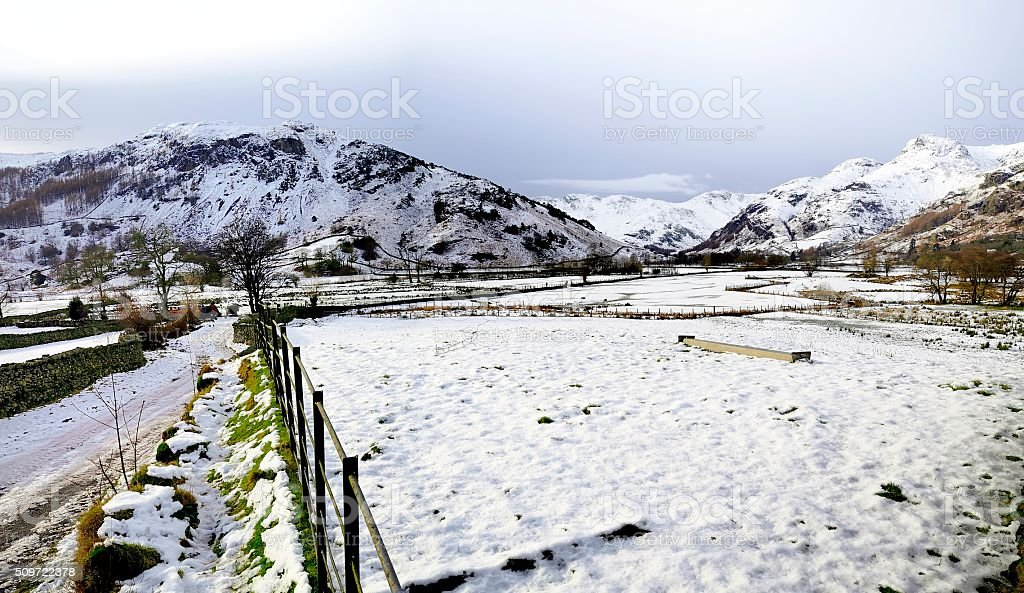 Snow over the Langdale valley stock photo