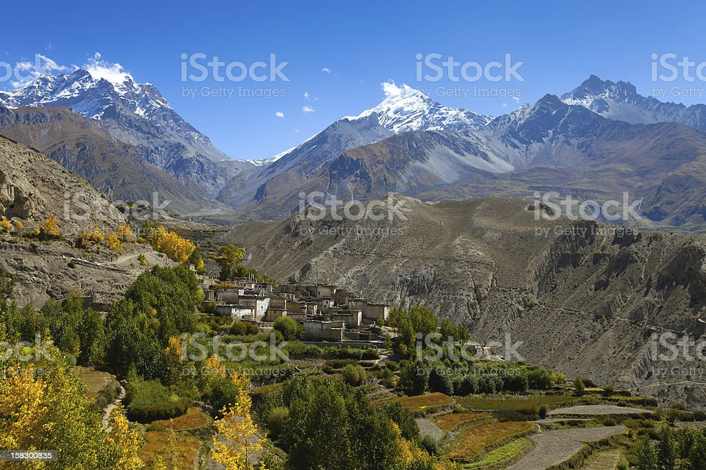 Snow peak mountains with village in front, Nepal stock photo