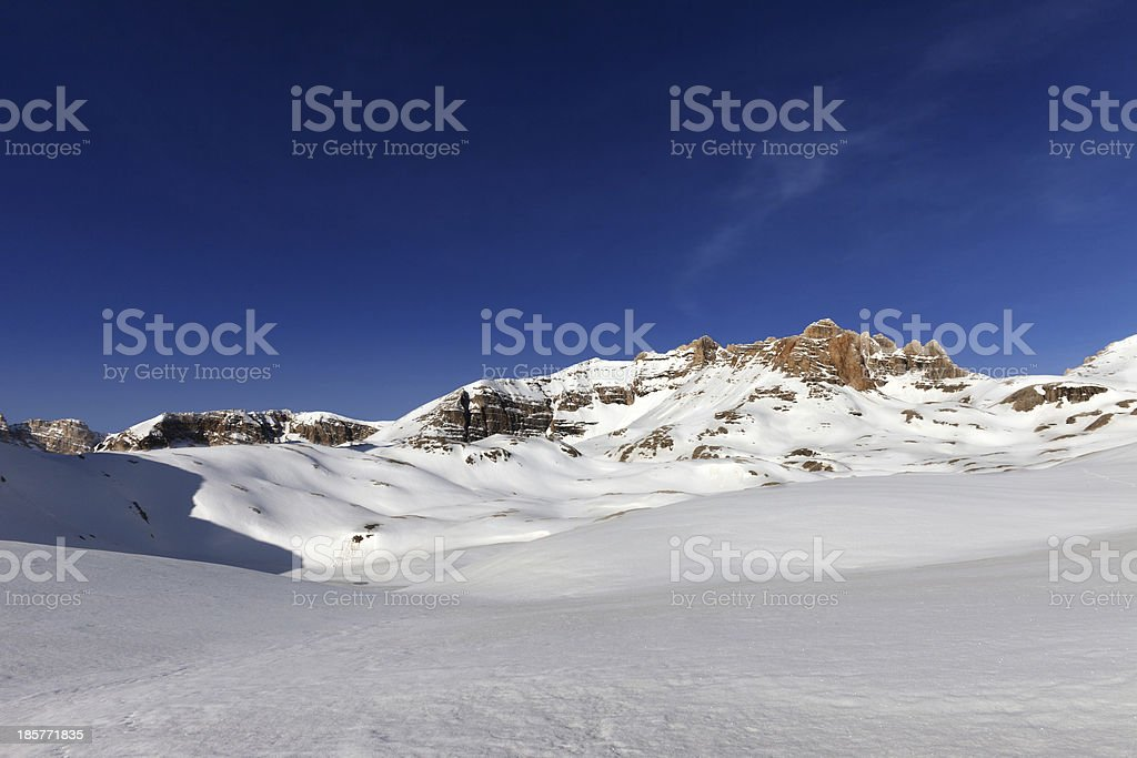 Snow plateau and blue sky in sunny spring day royalty-free stock photo