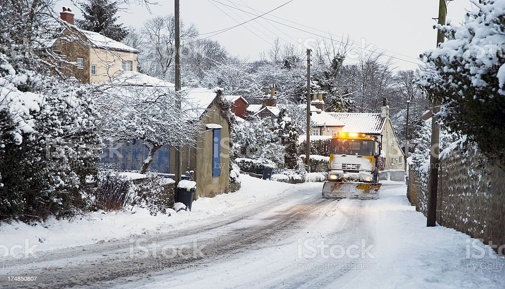 snow plough in North Yorkshire village royalty-free stock photo