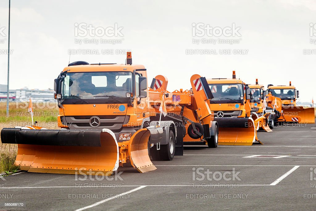 Snow plough trucks waiting for winter stock photo