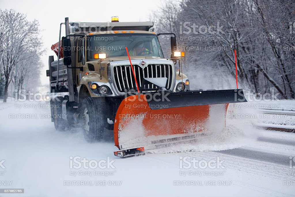 Snow Plow Clearing the Road stock photo