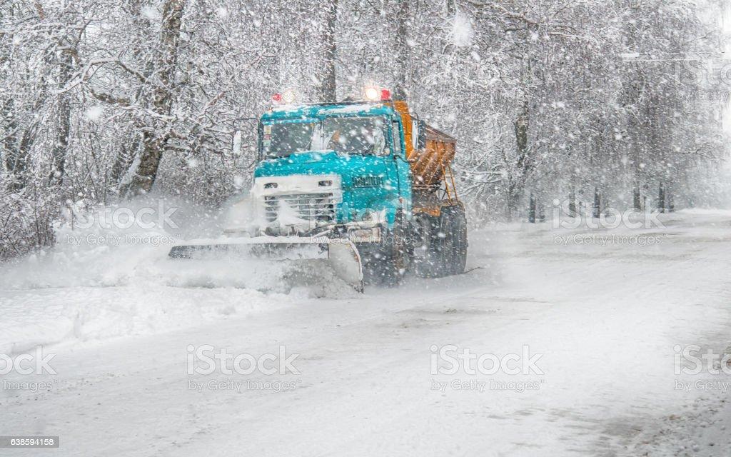 snow plow doing stock photo
