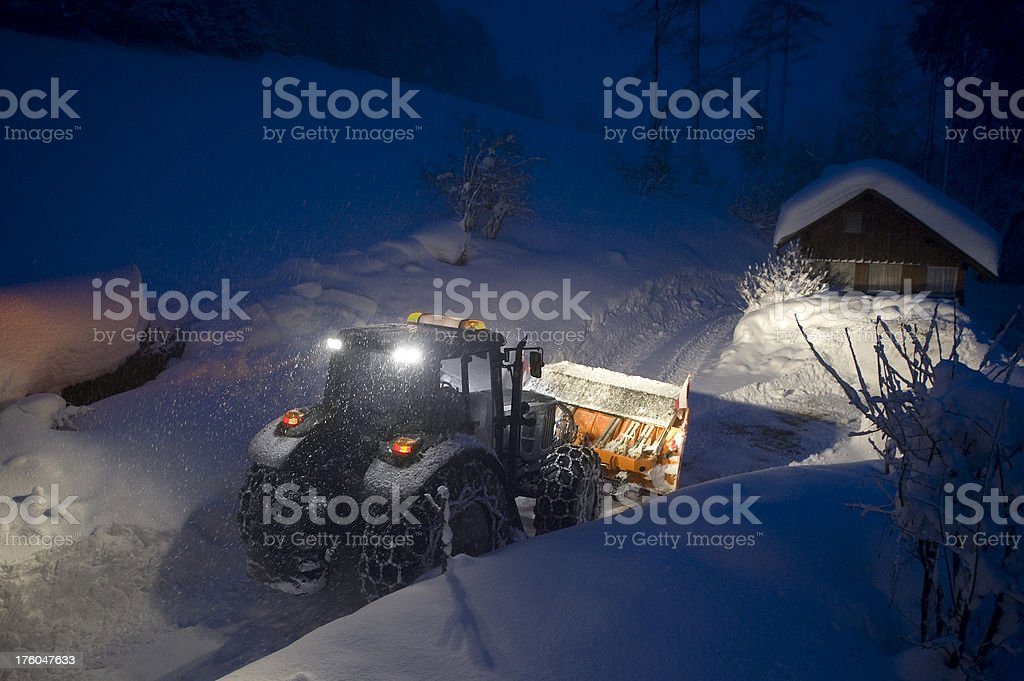 Snow Plow in a heavy storm blizzard stock photo